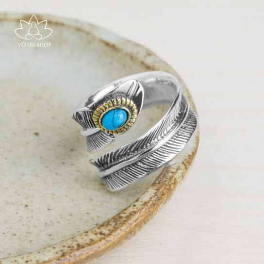 Silver ring formed as feather engraved turquoise
